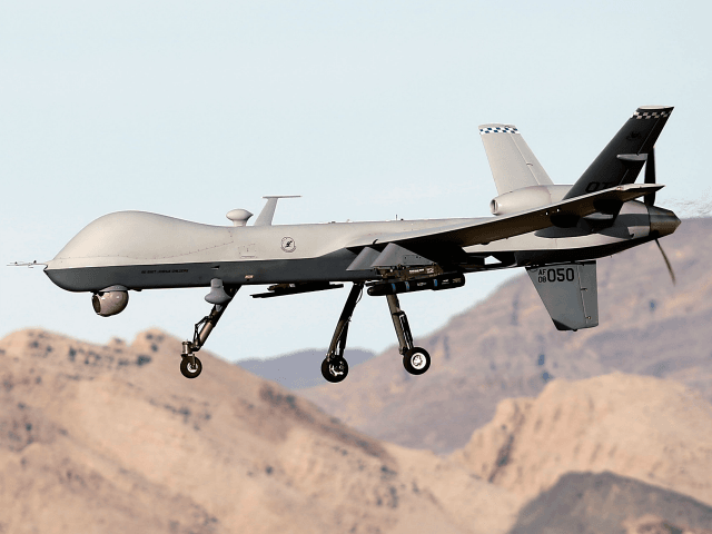 An MQ-9 Reaper remotely piloted aircraft (RPA) flies by during a training mission at Creech Air Force Base on November 17, 2015 in Indian Springs, Nevada. The Pentagon has plans to expand combat air patrols flights by remotely piloted aircraft by as much as 50 percent over the next few …