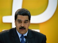 Venezuela's President Nicolas Maduro delivers a speach during a press conference to launch to the market a new oil-backed cryptocurrency called 'Petro', at the Miraflores Presidential Palace in Caracas, on February 20, 2018. Venezuela formally launched its new oil-backed cryptocurrency on Tuesday in an unconventional bid to haul itself out …