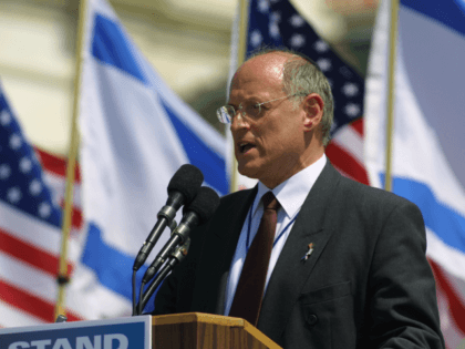 Malcolm Hoenlein, Executive Vice Chairman of the Conference of Presidents of Major American Jewish Organizations, speaks during a rally for solidarity with Israel April 15, 2002 on Capitol Hill in Washington, DC. Organizers said that more than 100,000 people attended the event, making it the biggest rally ever in support …