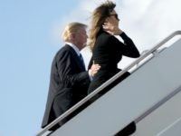 President Donald Trump, accompanied by first lady Melania Trump and their son Barron Trump board Air Force One at Palm Beach International Airport in West Palm Beach, Fla., Monday, Feb. 19, 2018, to travel to Andrews Air Force Base, Md. (AP Photo/Andrew Harnik)