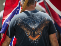 A pro-Confederate flag demonstrator wears a National Rifle Association t-shirt at the South Carolina Statehouse on July 10, 2017 in Columbia, South Carolina. To mark the two year anniversary of the removal of the Confederate battle flag from statehouse grounds, demonstrators erected a pole and flew a replica for several …