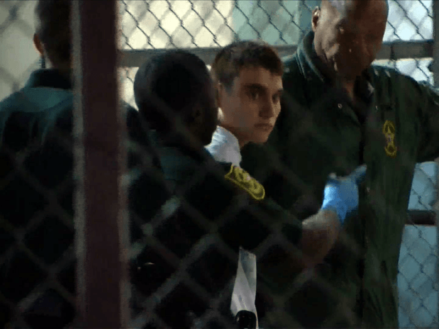 This video screen grab image shows shooting suspect Nikolas Cruz on February 15, 2018 at Broward County Jail in Ft. Lauderdale, Florida. The heavily armed teenager who gunned down students and adults at a Florida high school was charged Thursday with 17 counts of premeditated murder, court documents showed. Nikolas …