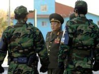North Korea's chief delegate Kim Yong-Chol (C) walks by South Korean soldiers after the inter-Korean general talks at the south side of the truce village of Panmunjom, in the Demilitarized Zone, 14 December 2007. High-level military talks between North and South Korea ended without agreement on a proposed joint fishing area to avert clashes. AFP PHOTO/POOL/JUNG YEON-JE (Photo credit should read JUNG YEON-JE/AFP/Getty Images)