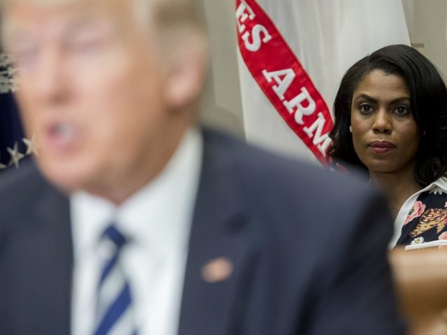 Omarosa Manigault (R), White House Director of Communications for the Office of Public Liaison, sits behind US President Donald Trump as he speaks during a meeting with teachers, school administrators and parents in the Roosevelt Room of the White House in Washington, DC, February 14, 2017. / AFP / SAUL …