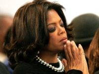Atlanta, UNITED STATES: US television personality Oprah Winfrey prays during a musical tribute to Coretta Scott King at the new Ebenezer Church 06 February, 2006 in Atlanta, Georgia. King's casket will lie in Ebenezer Baptist Church, where her husband the Rev. Martin Luther King Jr. preached in the 1960s and …