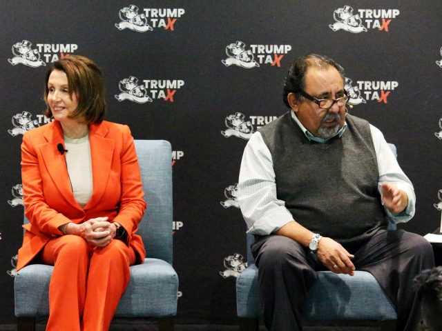 Democratic U.S. Rep. Nancy Pelosi, left, listens as U.S. Rep. Raul Grijalva addresses a town hall in Phoenix, Tuesday, Feb. 20, 2018. Pelosi told supporters in Phoenix, Tuesday that the Republican tax cuts will have dire effects on the middle class in Arizona and across the nation. (AP Photo/Bob Christie)