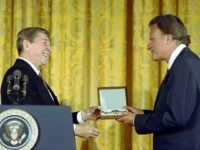2/23/1983 President Reagan presenting Presidential Medal of Freedom to Bill Graham in the East Room