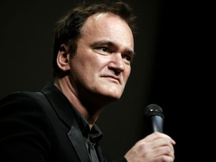 FILE - In this Oct. 18, 2013 file photo, director Quentin Tarantino delivers a speech before receiving the Lumiere Award during the 5th edition of the Lumiere Festival, in Lyon, central France. Tarantino sued Gawker Media LLC on Monday, Jan. 27, 2014, in Los Angeles for copyright infringement over the …