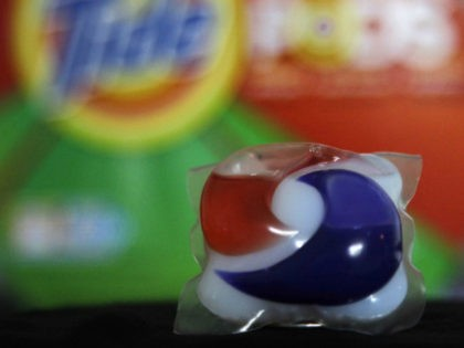 Laundry detergent makers introduced miniature packets in recent months such as this one photographed Thursday, May 24, 2012, in Houston. But doctors across the country say children are confusing the tiny, brightly colored packets with candy and swallowing them. Nearly 250 cases have been reported to poison control centers. (AP …