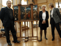 French Culture Minister Francoise Nyssen, right, poses with Henrietta Schubert , second right, and Christopher Bromberg, left, grandchildren of Henry and Hertha Bromberg, next to the oil work entitled 'Triptych of the Crucifixion' attributed to Flemish painter Joachim Patinir during a ceremony of restitution at Culture ministry in Paris, Monday, …