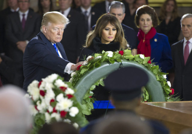 President Donald Trump and first lady Melania Trump present a wreath at Rev. Billy Graham's casket as he lies in honor in the Capitol Rotunda, Wednesday, Feb. 28, 2018 in Washington. (Ron Sachs/Pool via AP)