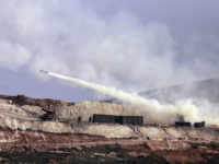 Turkish artillery fires toward Syrian Kurdish positions in Afrin area, Syria, from Turkish side of the border in Hatay, Turkey, Friday, Feb. 9, 2018. Turkish jets have resumed airstrikes in the Syrian Kurdish-run enclave of Afrin after a brief lull killing and wounding several people, the military and media reports …