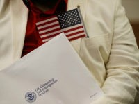 HIALEAH, FL - JANUARY 12: Marcel Cioffi, orginally from Venezuela, prepares to become an American citizen during a U.S. Citizenship & Immigration Services naturalization ceremony at the Hialeah Field Office on January 12, 2018 in Hialeah, Florida. 150 people from different countries around the world took part in the Oath of Allegiance. (Photo by Joe Raedle/Getty Images)