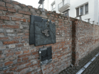 "A fragment of the former Warsaw Ghetto wall in Sienna 53 street that regional official for preservation of historical sites wants put on a list of protected historical monuments, in Warsaw, Poland, Tuesday, Feb. 20, 2018. The wall was built in 1940, when the Nazi Germans closed the area of Warsaw they called the ""Jewish district."" (AP Photo/Czarek Sokolowski)"