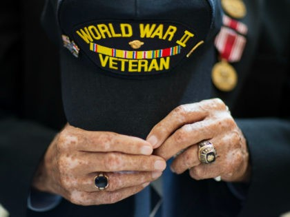World War II veteran Stanley Byars, 92, of Atlanta, center, holds his hat during the singing of the National Anthem at a ceremony awarding the French Legion of Honor medal to Byars and fellow veterans by the Consul General of France at the Capitol Thursday, June 4, 2015, in Atlanta. …