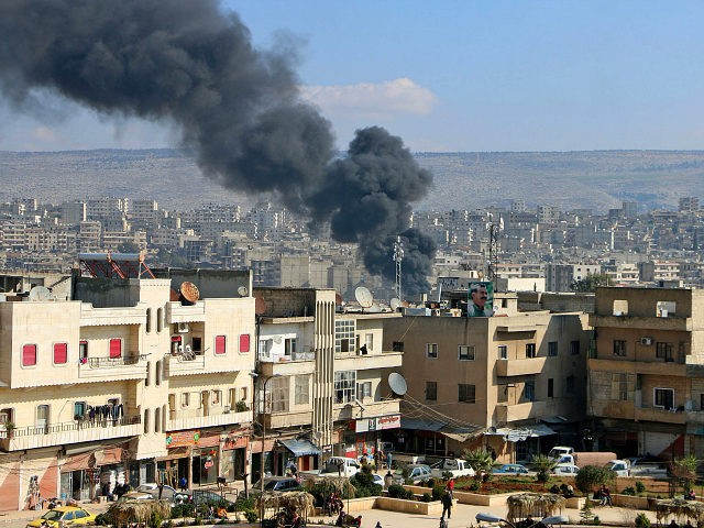 TOPSHOT - Smoke is seen billowing from the northern Syrian Kurdish town of Afrin on January 31, 2018. Turkey and allied Syrian rebel groups launched operation Olive Branch on January 20 against the Kurdish People's Protection Units (YPG), which controls the Afrin region. / AFP PHOTO / Ahmad Shafie BILAL …