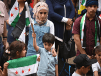 n this photo taken on October 11, 2015 ethnic Syrians attend a rally in support of refugees and asylum seekers in Sydney. Australian doctors on October 12, 2015 ramped up pressure on the government over its hardline policy on asylum-seekers, saying children they treat from immigration centres should not be returned to detention where conditions could harm them. / AFP / PETER PARKS (Photo credit should read PETER PARKS/AFP/Getty Images)