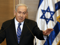 Israeli Prime Minister Benjamin Netanyahu speaks during a joint press conference with Kadima party leader Shaul Mofaz at the Knesset, Israel's parliament, in Jerusalem on May 8, 2012. Netanyahu struck a surprise deal with the opposition Kadima party to form a national unity government, axing plans for a snap election. …