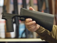 A bump stock device that fits on a semi-automatic rifle to increase the firing speed, making it similar to a fully automatic rifle, is shown here at a gun store on October 5, 2017 in Salt Lake City, Utah. Congress is talking about banning this device after it was reported …
