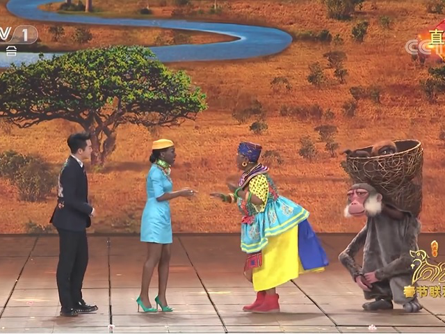 A Chinese Lunar New Year television show is facing accusations of racism after featuring a routine starring a woman wearing face paint and enlarged buttocks to appear African.