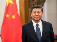Xi Jinping, China's president, waits to greet Theresa May, U.K. prime minister, ahead of their bilateral meeting at the Diaoyutai State Guest House in Beijing, China, on Thursday, Feb. 1, 2018. May is leading the largest business delegation her government has ever taken overseas as she seeks to put her …