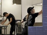 Workers clean inside a still-closed Chipotle restaurant Monday, Nov. 9, 2015, in Seattle. Health officials in Washington and Oregon have said that more than three dozen people have gotten sick with E. coli in an outbreak linked to Chipotle restaurants in the two states. More than 40 Chipotle restaurants remain …
