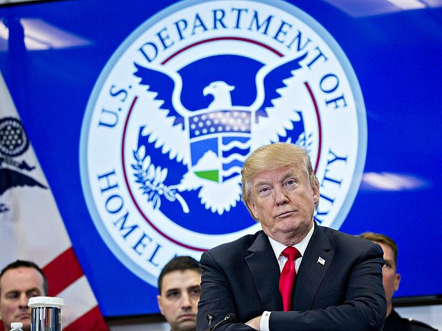 U.S. President Donald Trump listens during a Customs and Border Protection (CBP) roundtable discussion after touring the CBP National Targeting Center in Sterling, Virginia, U.S., on Friday, Feb. 2, 2018. Trump is looking to ratchet up pressure on lawmakers to consider the immigration proposal he unveiled in Tuesday's State of …