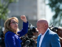 UNITED STATES - OCTOBER 2: Former Congresswoman Gabrielle Giffords, D-Ariz., turns to shake her fist at the Capitol as her husband retired NASA astronaut Captain Mark Kelly looks on during their news conference at the U.S. Capitol on Monday, Oct. 2, 2017, to respond to last nights tragic mass shooting …
