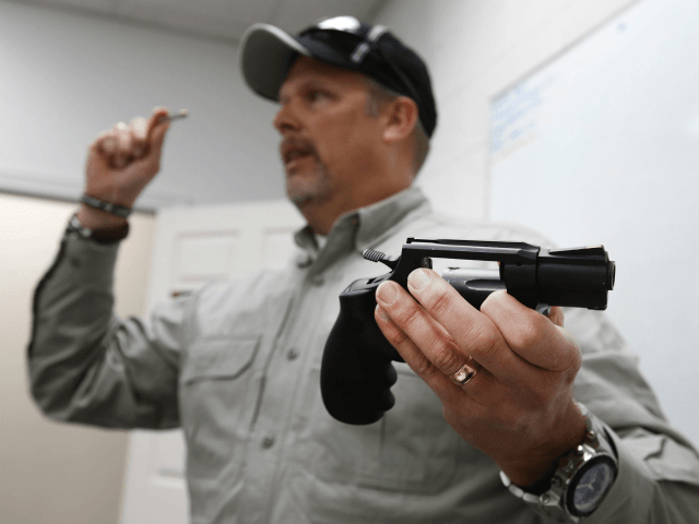 Gun instructor Mike Stilwell, demonstrates a revolver as as he teaches a packed class to obtain the Utah concealed gun carry permit, at Range Master of Utah, on January 9, 2016 in Springville, Utah. Utahs permits, available for a fee to non-residents who meet certain requirements, are among the most …