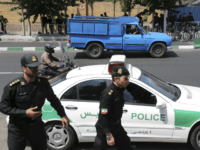 Iranian police control the scene in front of the British Embassy in Tehran prior to arrival of the British Foreign Secretary Philip Hammond to reopen the Embassy, Iran, Sunday, Aug. 23, 2015. Iran's state TV says British Foreign Secretary Philip Hammond has reopened the British Embassy in Tehran nearly four years after it closed following an attack by hardliners. Hammond's visit is the first by a British foreign secretary to Iran since 2003. (AP Photo/Ebrahim Noroozi)