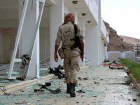 A fighter from the separatist Southern Transitional Council gather on February 25, 2018, at the site of two suicide car bombings that targeted the headquarters of an anti-terror unit the day before, in the southern Yemeni port of Aden. Five people, including security officers and a child, died in the blasts at the headquarters of an anti-terror unit in the Tawahi district, Aden security chief General Shallal al-Shae said. / AFP PHOTO / SALEH AL-OBEIDI (Photo credit should read SALEH AL-OBEIDI/AFP/Getty Images)