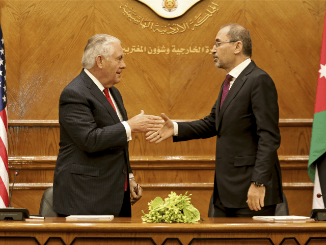 U.S. Secretary of State Rex Tillerson, left, shakes hands with Jordan's Foreign Minister Ayman Safadi in Amman, Jordan, Wednesday, Feb. 14, 2018. The Trump administration is set to boost aid to Jordan by more than $1 billion over the next five years, in spite of President Donald Trump's repeated threats …