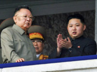 Pyongyang, North Korea - Photo taken on Oct. 10, 2010, shows North Korean leader Kim Jong Il (L) and Kim Jong Un (R), a son of Jong Il, reviewing a military parade marking the 65th anniversary of the founding of the ruling Workers Party of Korea in Pyongyang. North Korea announced Dec. 19, 2011, through its official Korean Central News Agency that Kim Jong Il died on Dec. 17, 2011, at the age of 69. (Photo by Kyodo News via Getty Images)