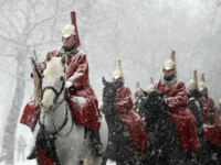 Members of the Household Cavalry return to their barracks as snow falls in London, Wednesday, Feb. 28, 2018. Britain, which is buffered by the Atlantic Ocean and tends to have temperate winters, saw heavy snow in some areas that disrupted road, rail and air travel and forced hundreds of schools …