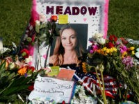 A memorial for Meadow Pollack, one of the victims of the Marjory Stoneman Douglas High School shooting, sits in a park in Parkland, Florida on February 16, 2018. A former student, Nikolas Cruz, opened fire at the Florida high school leaving 17 people dead and 15 injured. / AFP PHOTO …