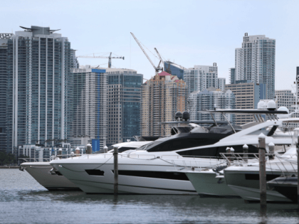 Skyscrapers and residential buildings line the beach April 4, 2016 in Miami, Florida. A report by the International Consortium of Investigative Journalists referred to as the 'Panama Papers,' based on information anonymously leaked from the Panamanian law firm Mossack Fonesca, indicates possible connections between condo purchases in South Florida and …