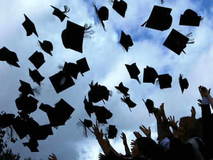 Students throw their mortarboards in the air during their graduation photograph at the University of Birmingham degree congregations on July 14, 2009 in Birmingham, England