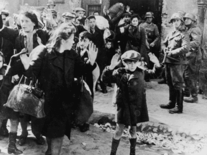 Jews from the Warsaw ghetto surrender to German soldiers after the Warsaw Ghetto Uprising of April-May 1943. On the right is SS Josef Blösche (1912 - 1969). (Photo by Keystone/Hulton Archive/Getty Images)