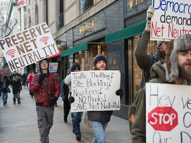Demonstrators protest a plan by the Federal Communications Commission (FCC) to repeal net neutrality outside a Verizon store on December 7, 2017 in Chicago, Illinois. (Photo by Patrick Gorski/NurPhoto via Getty Images)