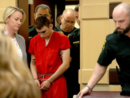 FT. LAUDERDALE - FEBRUARY 19: Nikolas Cruz appears in court with attorney Melissa McNeil (L) for a status hearing before Broward Circuit Judge Elizabeth Scherer on February 19, 2018 in Ft. Lauderdale, Florida. Cruz is facing 17 charges of premeditated murder in the mass shooting at Marjory Stoneman Douglas High …