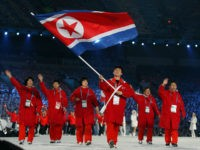 FEBRUARY 12: Song Chol Ri of North Korea carries the national flag during the Opening Ceremony of the 2010 Vancouver Winter Olympics at BC Place on February 12, 2010 in Vancouver, Canada. (Photo by Cameron Spencer/Getty Images)