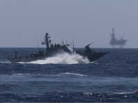 An Israeli Navy vessel passes by the Tamar drilling natural gas production platform during a squadron exercise on May 27, 2013 off the coast of Israel in the Mediterranean Sea. Israel launched a nation-wide exercise today to test the civilian population's response to a possible massive rocket attack from three …