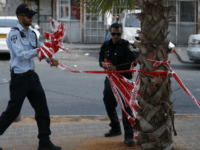 Israeli policemen remove the barrier tape at the scene where police said a Jewish man was stabbed with a screwdriver in the east Jerusalem neighborhood of Al-Tur on August 11, 2016 A Palestinian man stabbed and wounded a young Jewish man in Jerusalem before fleeing, in what Israeli police said …