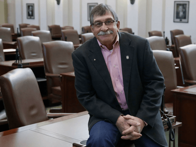 Oklahoma state rep Rick West poses for a photo in the House chamber at the capitol in Oklahoma City.