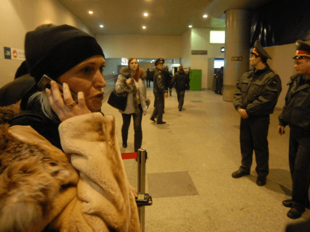 A woman speaks by phone at the Domodedovo airport in Moscow after an explosion on January 24, 2011. A suicide bomber killed at least 35 people and many injured at the Russian largest international airport. UPI