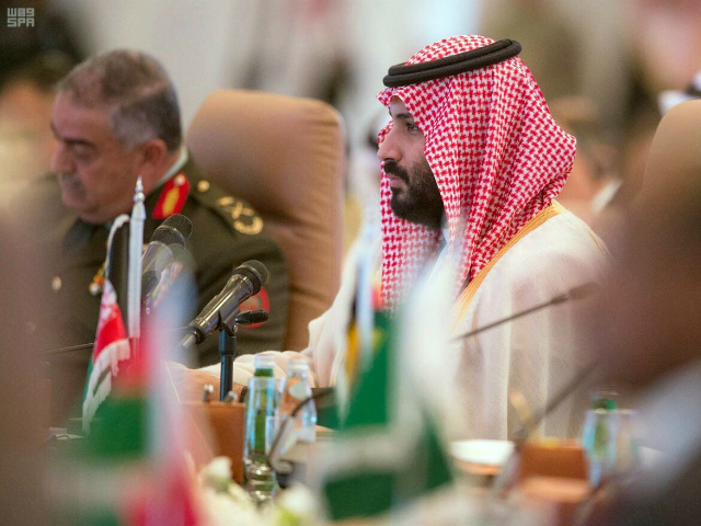 In this photo released by the state-run Saudi Press Agency, Saudi Crown Prince Mohammed bin Salman speaks at a meeting of the Islamic Military Counterterrorism Alliance in Riyadh, Saudi Arabia, Sunday, Nov. 26, 2017. Saudi Arabia's assertive crown prince on Sunday opened the first high-level meeting of a kingdom-led alliance …