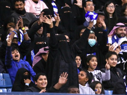 Female supporters of Saudi's Al-Hilal attend their team's football match against Al-Ittihad in the Saudi Pro League at the King Fahd International Stadium in Riyadh on January 13, 2018. Saudi Arabia allowed women to enter a football stadium for the first time to watch a match on January 12, as …
