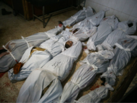 The bodies of civilians who were killed in Syrian army bombardment on the town of Hamouria in the rebel-held enclave of Eastern Ghouta are seen lying on the ground at a make-shift morgue the morning after the attacks on February 20, 2018. / AFP PHOTO / ABDULMONAM EASSA (Photo credit should read ABDULMONAM EASSA/AFP/Getty Images)