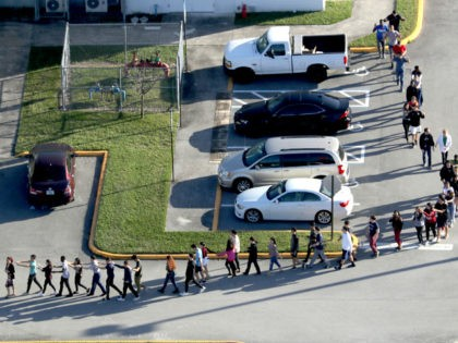 Students are evacuated by police out of Stoneman Douglas High School in Parkland, Fla., after a shooting on Wednesday, Feb. 14, 2018. (Mike Stocker/Sun Sentinel/TNS via Getty Images)