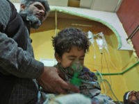 Syrian children and adults receive treatment for a suspected chemical attack at a makeshift clinic on the rebel-held village of al-Shifuniyah in the Eastern Ghouta region on the outskirts of the capital Damascus late on February 25, 2018. A child died and at least 13 other people suffered breathing difficulties …